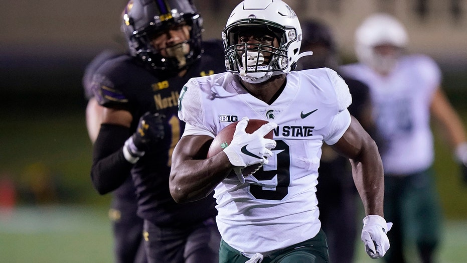 Walker runs for 264 yards as Spartans beat Wildcats 38-21