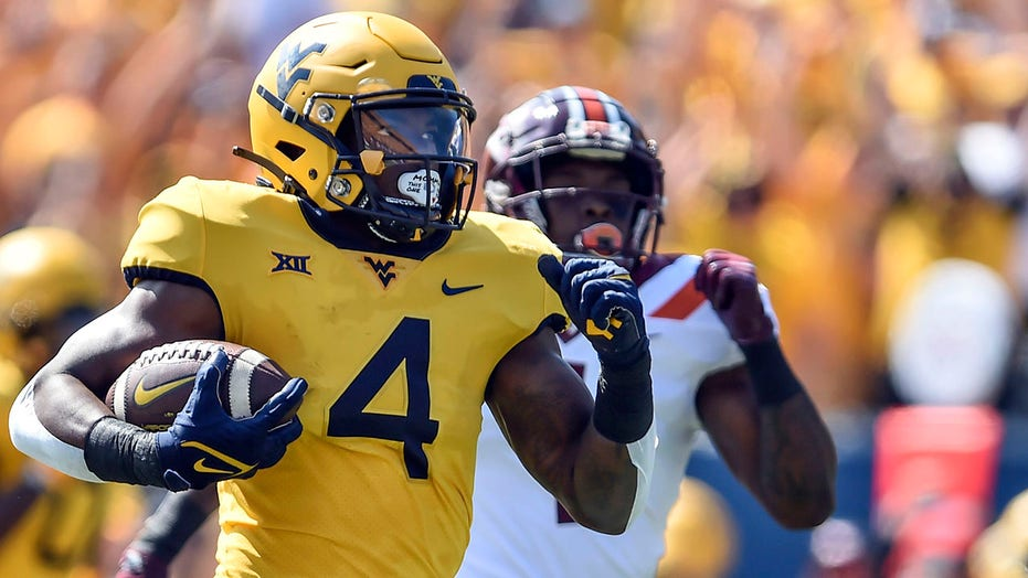 WVU builds big lead, holds on to beat No. 15 Va Tech 27-21