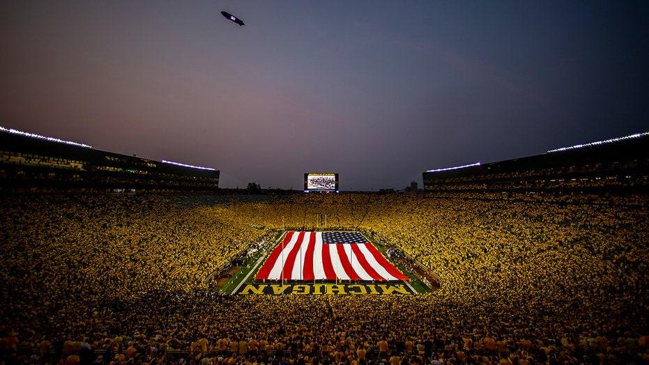 Michigan beats Washington 31-10 after Harbaugh's trick play