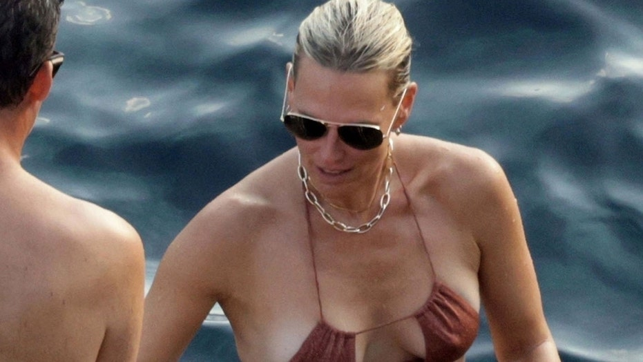 Molly Sims, 48, showcases youthful physique in a string bikini amid romantic trip to Italy