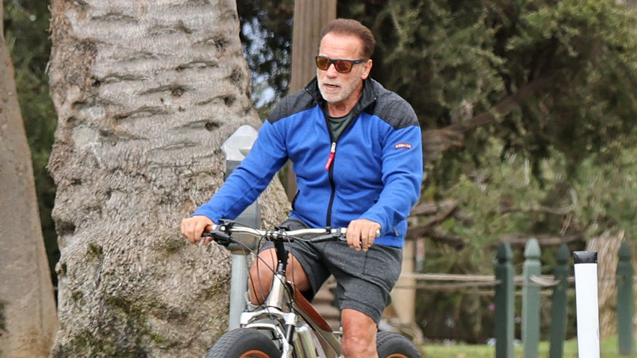 Arnold Schwarzenegger spotted enjoying a bike ride while wearing medical boot