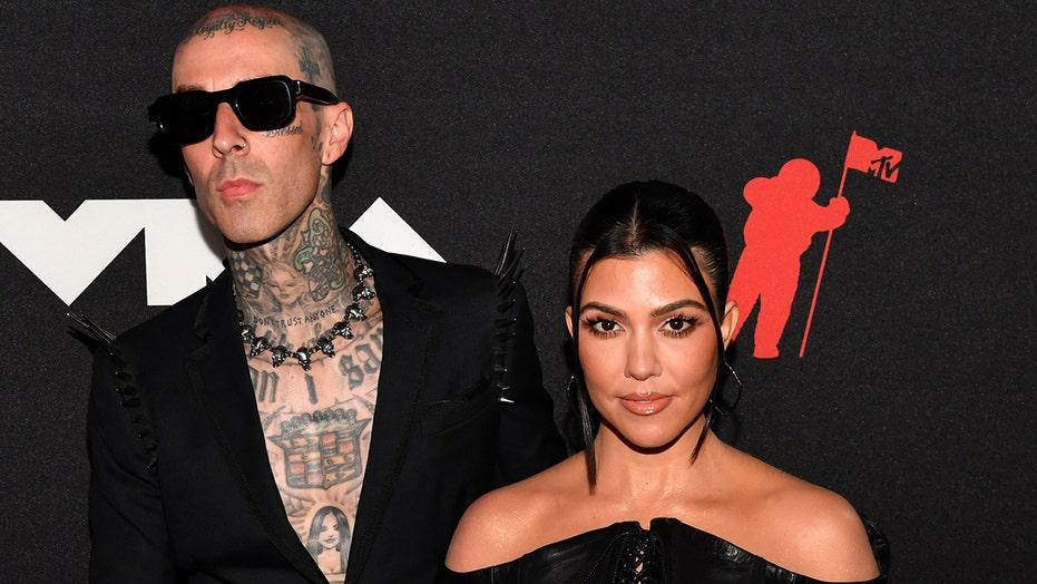 Kourtney Kardashian, Travis Barker make red carpet debut at 2021 MTV VMAs