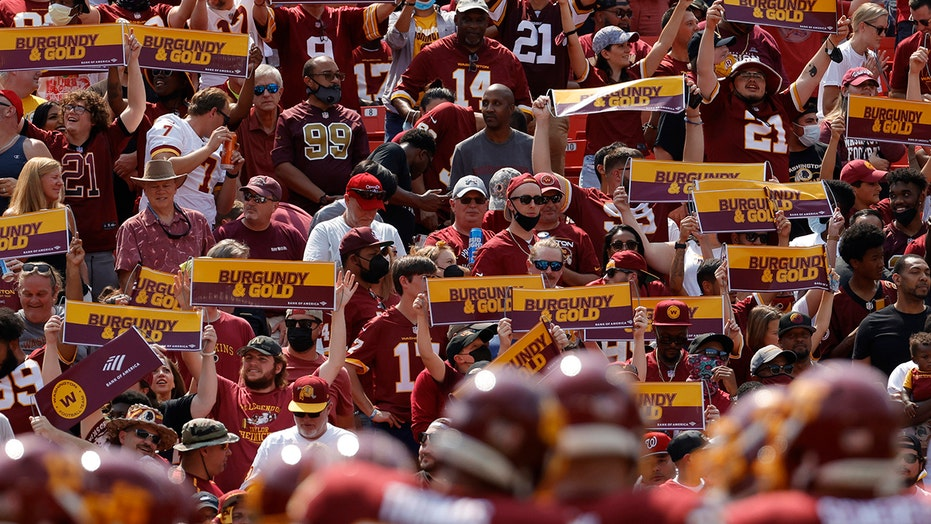 Washington fans get into violent scrap during team's loss to Chargers