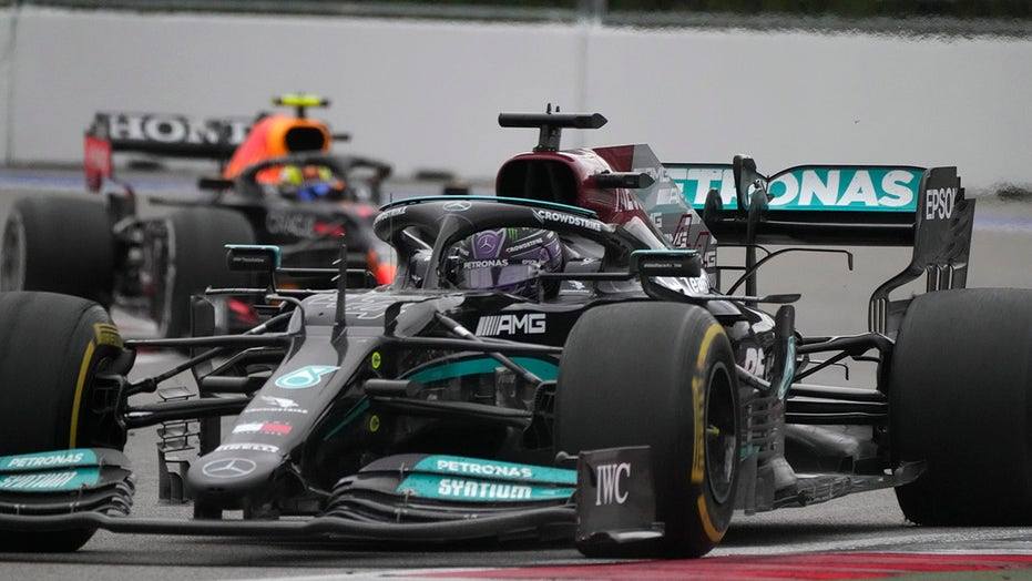 Lewis Hamilton wins record 100th F1 Grand Prix at wet and wild Russia race