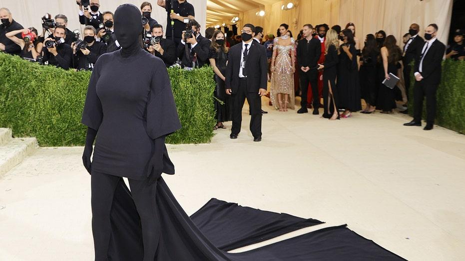Kim Kardashian walks 2021 Met Gala in head-to-toe black Balenciaga ensemble
