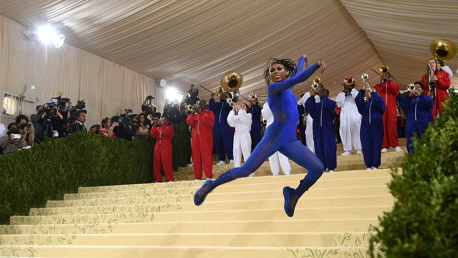 The Met Gala 2021 kicks off with marching band and sparkly looks
