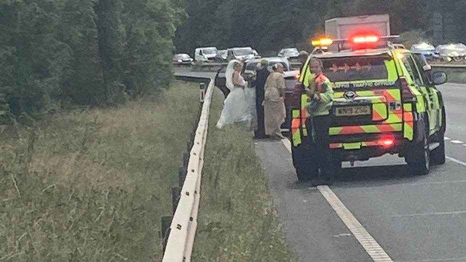 Police rescue bride after her car breaks down on the way to her wedding