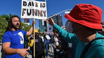 Netflix protesters furious over Chapelle special attack man with 'We like Dave' sign