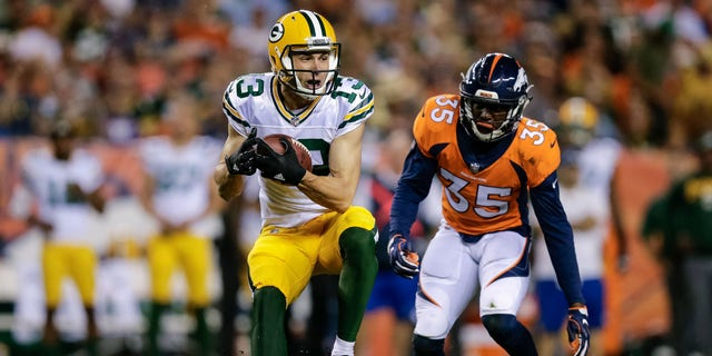 August 26, 2017;  Denver, CO, USA;  Green Bay Packers wide receiver Max McCaffrey (13) catches Denver Broncos safety Diamonte Thomas (35) in the third quarter at Sports Authority Grounds at Mile High.  Mandatory Credit: Isiah J.  Downing-USA Today Sports