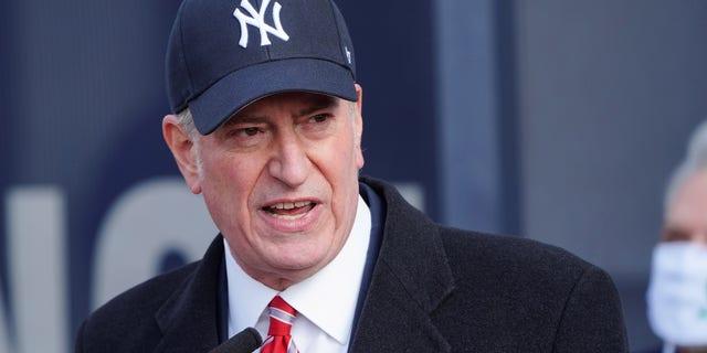 New York's Mayor Bill de Blasio makes declarations at a mass vaccination site at Yankee Stadium amid the coronavirus disease (COVID-19) pandemic in the Bronx borough of New York City, New York, U.S., February 5, 2021. REUTERS/Carlo Allegri