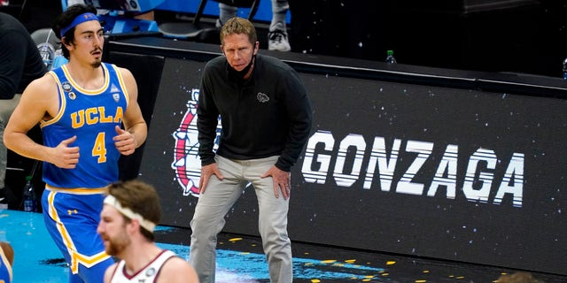 During the semifinals of the Final Four of the 2021 NCAA Tournament, Gonzaga head coach Mark Few watched the court action during the semifinals on Saturday, April 3, 2021 at the Lucas Oil Stadium in Indianapolis.  Sports