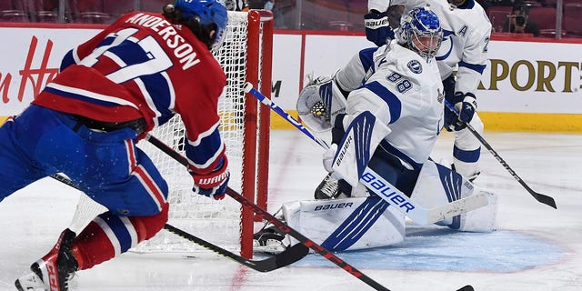Montreal Canadiens right wing Josh Anderson (17) shoots and scores against Tampa Bay Lightning goaltender Andrei Vasilevskiy (88) during the overtime period in game four of the 2021 Stanley Cup Final on July 5, 2021, at the Bell Centre in Montreal.