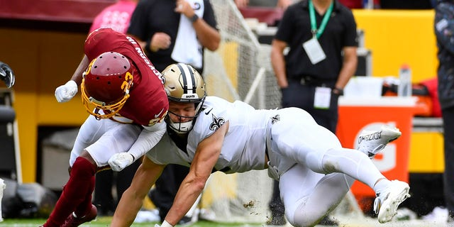 New Orleans Saints wide receiver Taysom Hill (7) suffers an apparent neck injury against the Washington Football Team during the first half at FedExField.
