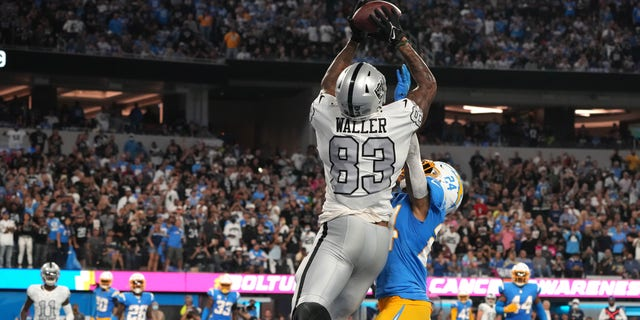 Oct 4, 2021; Inglewood, California, USA; Las Vegas Raiders tight end Darren Waller (83) catches a pass for a touchdown over Los Angeles Chargers defensive back Nasir Adderley (24) during the second half at SoFi Stadium. Mandatory Credit: Kirby Lee-USA TODAY Sports