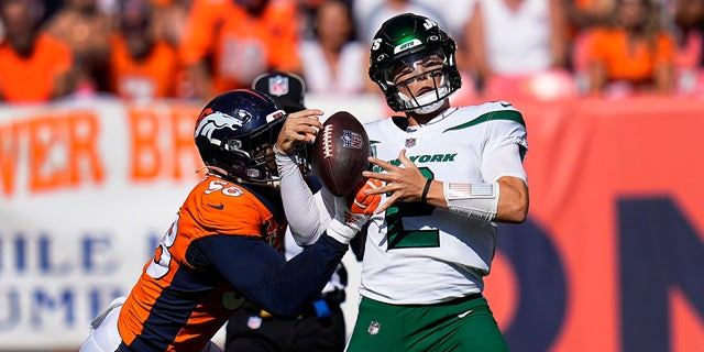 New York Jets quarterback Zach Wilson (2) is sacked by Denver Broncos outside linebacker Von Miller (58) during the first half of an NFL football game, Sunday, Sept. 26, 2021, in Denver.
