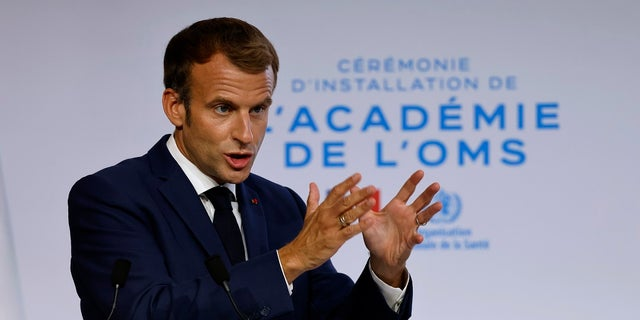 French President Emmanuel Macron delivers his speech during the opening of the World Health Organisation Academy in Lyon, central France, on Monday.