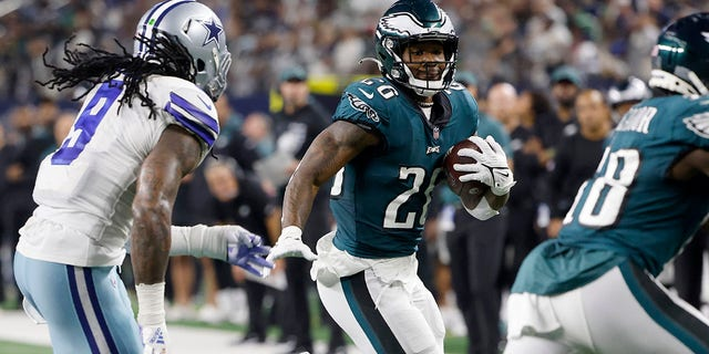 Dallas Cowboys linebacker Jaylon Smith (9) gives chase as Philadelphia Eagles running back Miles Sanders (26) runs the ball in the second half of an NFL football game in Arlington, Texas, Monday, Sept. 27, 2021. (AP Photo/Michael Ainsworth)