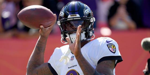 Baltimore Ravens quarterback Lamar Jackson (8) warms up prior to an NFL football game against the Denver Broncos, Sunday, Oct. 3, 2021, in Denver.