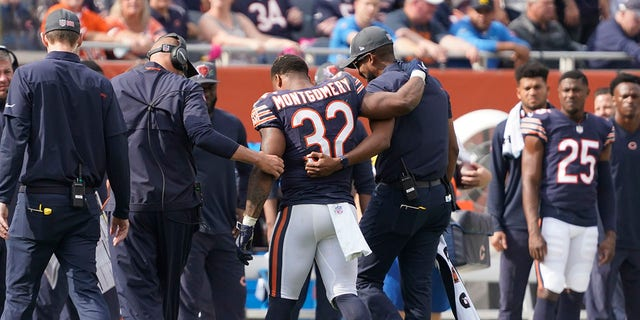 Chicago Bears running back David Montgomery is assisted off the field during the second half of an NFL football game against the Detroit Lions Sunday, Oct. 3, 2021, in Chicago. The Bears won 24-14.