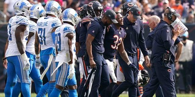 Chicago Bears running back David Montgomery (32) grimaces in pain as he leave the field after being injured during the second half of an NFL football game against the Detroit Lions Sunday, Oct. 3, 2021, in Chicago.