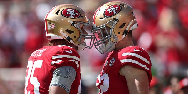 San Francisco 49ers tight end Ross Dwelley, right, is congratulated by George Kittle after catching a touchdown pass against the Seattle Seahawks during the first half of a game in Santa Clara, Calif., Sunday, Oct. 3, 2021.