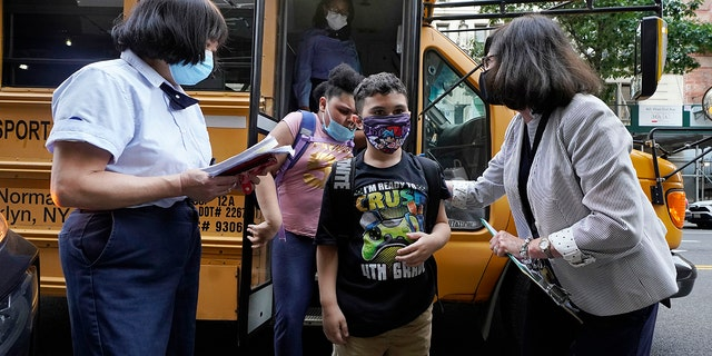 Students are welcomed by faculty as they arrive at PS811, New York, Monday, September 13, 2021.  (AP Photo / Richard Drew, file)