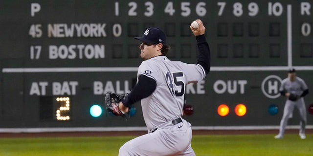New York Yankees starting pitcher Gerrit Cole delivers to the Boston Red Sox in the first inning of the American League Wild Card playoff game at Fenway Park, Tuesday Oct. 5, 2021 in Boston.