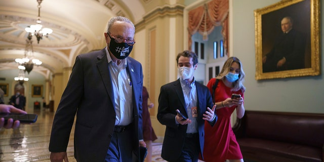 Senate Majority Leader Chuck Schumer, D-N.Y., finishes a meeting with White House officials and Senate Democrats before taking steps to move on the debt limit without Republican votes, at the Capitol in Washington, Wednesday, Oct. 6, 2021. (AP Photo/J. Scott Applewhite)