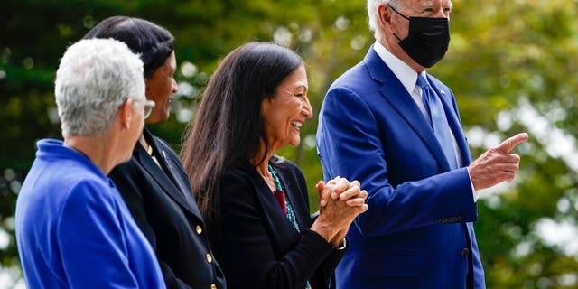 President Joe Biden hints at White House North Lawn in Washington, DC, Friday, Oct. 2021