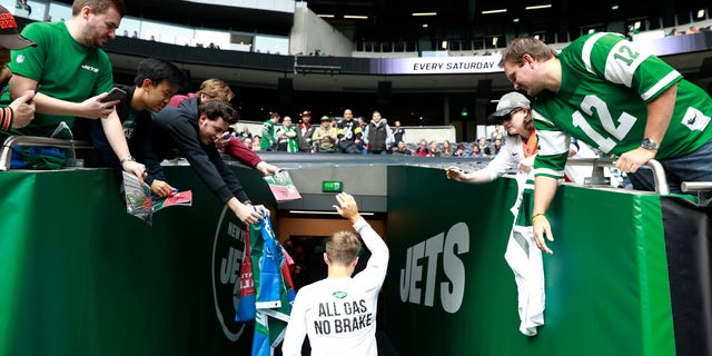 New York Jets quarterback Zach Wilson leaves the field after the first warm-up before an NFL football game between the Jets and the Atlanta Falcons at the Tottenham Hotspur stadium in London, England, Sunday, Oct. 10, 2021.