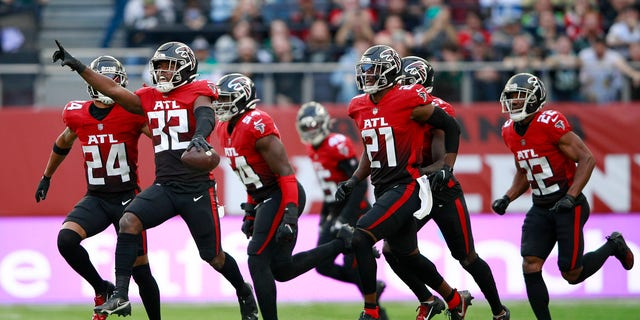 Atlanta Falcons safety Jaylinn Hawkins (32) celebrates making an interception during the first half of an NFL football game between the New York Jets and the Atlanta Falcons at the Tottenham Hotspur stadium in London, England, Sunday, Oct. 10, 2021.