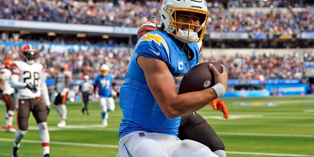 Los Angeles Chargers quarterback Justin Herbert scores a touchdown during the second half against the Cleveland Browns Sunday, Oct. 10, 2021, in Inglewood, Calif.