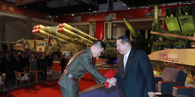 """Kim reviewed the rare exhibition and vowed to build an """"invincible"""" military, as he accused the United States of creating regional tensions and lacking action to prove it has no hostile intent toward the North, state media reported Tuesday."""