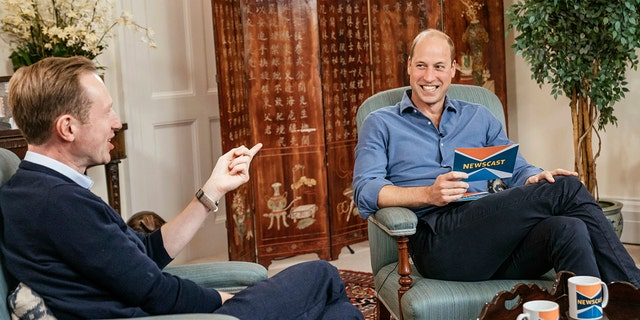 In this undated photo provided Tuesday, Oct. 12, 2021, Britain's Prince William, right, speaks with journalist Adam Fleming during the recording of an appearance on the program BBC Newscast, at Kensington Palace, London, in which Prince Williams discussed climate change ahead of the inaugural Earthshot Prize award ceremony on Sunday. (Kensington Palace via AP)