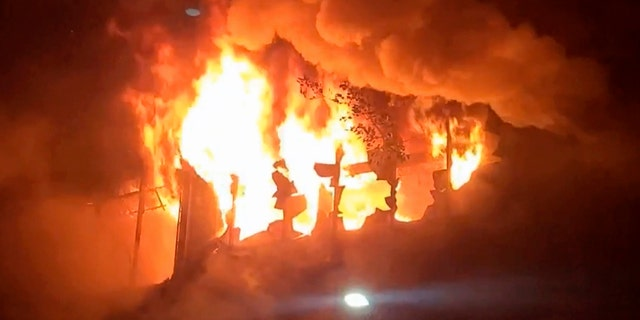 In this image taken from video by Taiwan's EBC, fire and smoke pour out from a building in Kaohsiung, in southern Taiwan on Thursday, Oct. 14, 2021. The fire engulfed a 13-story building overnight in southern Taiwan, the island's semi-official Central News Agency reported Thursday. (EBC via AP )