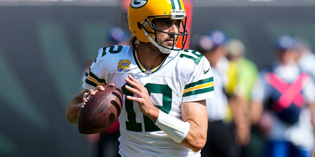 Green Bay Packers quarterback Aaron Rodgers throws against the Cincinnati Bengals in the first half of an NFL football game in Cincinnati, Sunday, Oct. 10, 2021.