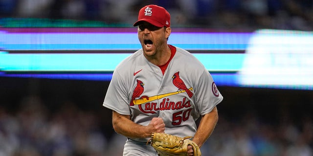 St. Louis Cardinals starting pitcher Adam Wainwright reacts after Los Angeles Dodgers' Trea Turner grounds out in to a double play during the third inning of a National League Wild Card playoff baseball game Wednesday, Oct. 6, 2021, in Los Angeles.