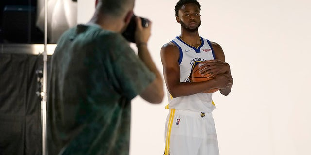 Golden State Warriors forward Andrew Wiggins, right, poses for photographer Noah Graham during the NBA basketball team's media day in San Francisco, Monday, Sept. 27, 2021.