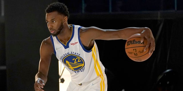 Golden State Warriors forward Andrew Wiggins poses for photos during the NBA basketball team's media day in San Francisco, Monday, Sept. 27, 2021.