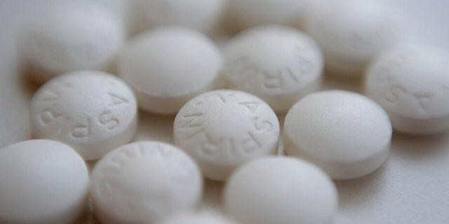 This Aug. 23, 2018, file photo shows an arrangement of aspirin pills in New York.