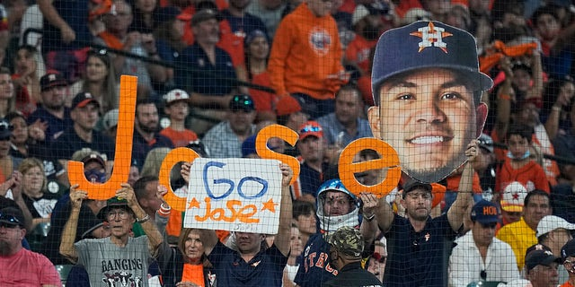 Spectators cheer for Houston Astros second baseman Jose Altuve during the first inning in Game 1 of a baseball American League Division Series between the Houston Astros and the Chicago White Sox Thursday, Oct. 7, 2021, in Houston.