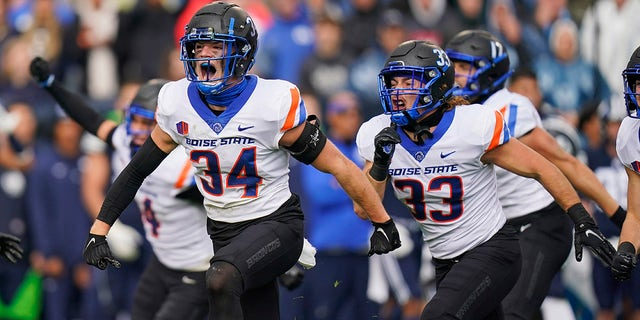 Boise State safety Alexander Teubner (34) celebrates a BYU fumble recovery in the first half during an NCAA college football game Saturday, Oct. 9, 2021, in Provo, Utah.