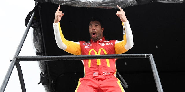 NASCAR Cup Series driver Bubba Wallace (23) celebrates after he was announced the winner of the YellaWood 500 at Talladega Superspeedway.