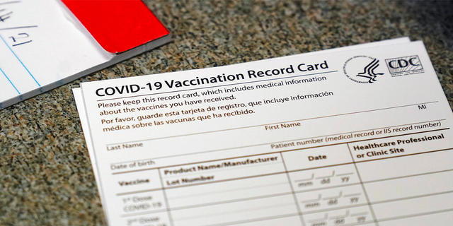 FILE: A COVID-19 vaccination record card is shown at Seton Medical Center in Daly City, Calif.
