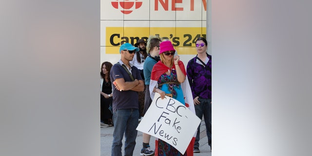 Supporters of the right-wing People's Party of Canada (PPC) attend a protest rally outside the Canadian Broadcasting Corporation (CBC) headquarters in Toronto, Ontario, Canada September 16, 2021. REUTERS/Chris Helgren