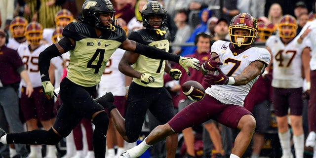 Minnesota Golden Gophers wide receiver Chris Autman-Bell (7) misses a pass in front of Purdue Boilermakers safety Marvin Grant (4) during the second quarter at Ross-Ade Stadium.
