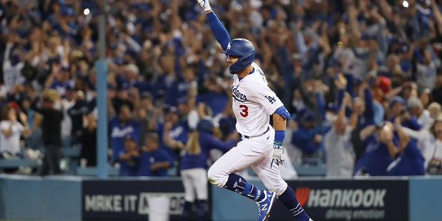 Chris Taylor #3 of the Los Angeles Dodgers celebrates his walk off two-run home run in the ninth inning to defeat the St. Louis Cardinals 3 to 1 during the National League Wild Card Game at Dodger Stadium on October 06, 2021 in Los Angeles, California.