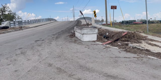 A coffin displaced after Hurricane Ida sits on the road outside Jean Lafitte, Louisiana.