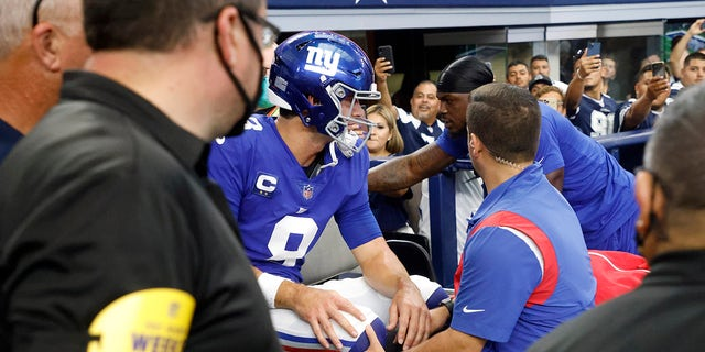 New York Giants' Daniel Jones (8) is carted off the field after suffering an unknown injury running the ball in the first half of a game against the Dallas Cowboys in Arlington, Texas, Sunday, Oct. 10, 2021.