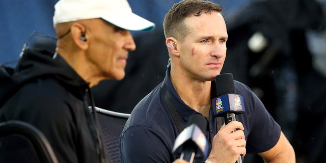 NBC commentator Drew Brees looks on before the game between the Tampa Bay Buccaneers and the New England Patriots at Gillette Stadium on October 03, 2021 in Foxborough, Massachusetts.